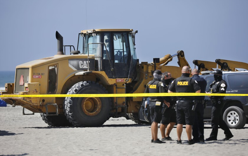 A woman died Monday after she was run over by a heavy equipment tractor on Oceanside Harbor Beach.