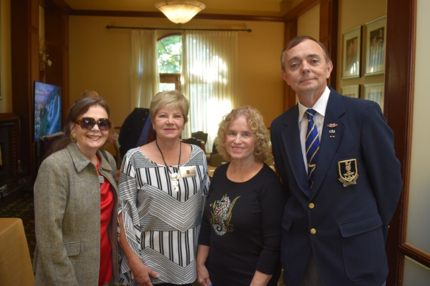 Master Sgt. Reynold Cindrich, a collector of military uniforms, spoke at a recent meeting of the Gen. J.P. Holland Chapter of the Military Order of the World Wars in the Country Club of Rancho Bernardo. Cindrich has acquired more than 200 uniforms from all branches of the United States military and from other countries. It is his goal to keep alive the memory of the veterans who wore these uniforms. Cindrich shared with the group stories of the bravery and patriotism of those who wore the uniforms. From left, several attendees Vivian Lewis, Dorene LeCault and Diane Herbka (treasurer) with Master Sgt. Cindrich.