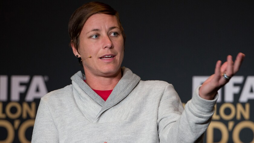 U.S. national team forward Abby Wambach speaks during a news conference in Zurich, Switzerland, on Jan. 12. A group of women's soccer players has dropped its discrimination lawsuit against FIFA.