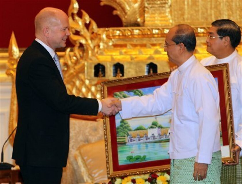 British Foreign Secretary William Hague, left, shakes hands with Myanmar's President Thein Sein during their meeting at the presidential palace in Naypyitaw, Myanmar Thursday, Jan. 5, 2012. Hague is on the first day of his two-day visit to Myanmar. (AP Photo/Apichart Weerawong)