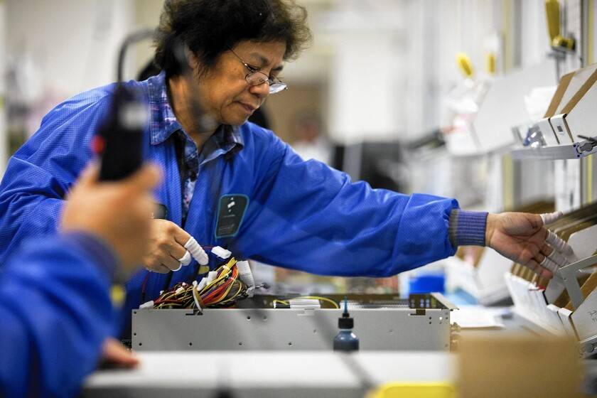 The fastest-growing sectors of manufacturing in California tend to be in the higher skilled advanced-technology realm. Above, an employee assembles a server at the Z Microsystems facility in San Diego.