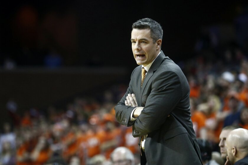 Virginia head coach Tony Bennett calls to his team during the first half of an NCAA college basketball game in Charlottesville, Va., on Monday, Feb. 15, 2016. (AP Photo/Ryan M. Kelly)