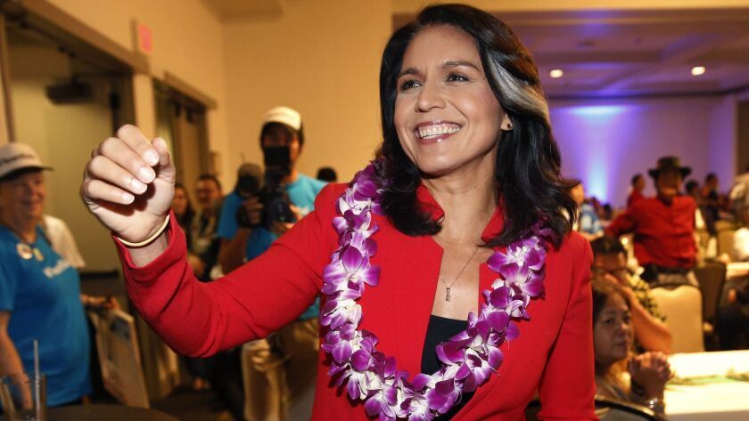 Rep. Tulsi Gabbard (D-Hawaii), who has announced a run for president, greets supporters in Honolulu. Her memoir is scheduled for publication this spring.