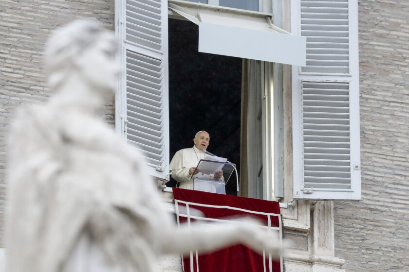 Pope Francis delivers his blessing as he recites the Angelus noon prayer from the window of his studio overlooking St.Peter's Square, at the Vatican, Sunday, Dec. 6, 2020. (AP Photo/Andrew Medichini)