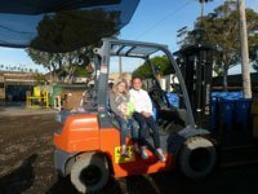 Grace Szczuka and Olivia Schroeder checking out the heavy equipment at the Del Mar Fairgrounds