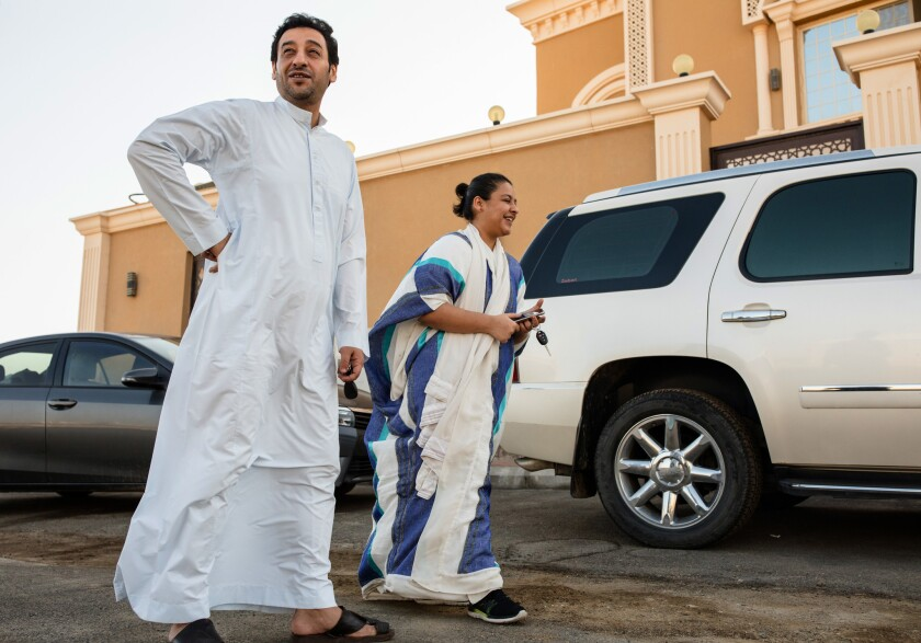 Tala Murad, a Saudi university student, and her father, Midhat, in front of their home in a northern suburb of Jidda. She is learning to drive so she can work for a regional smartphone-based ride-hailing service.