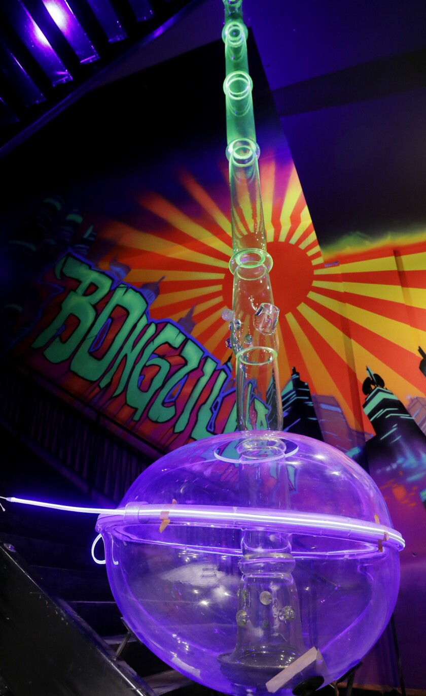 """LAS VEGAS, NV - AUGUST 30, 2018: A large bong titled """"Bongzilla"""" is under construction at Cannabitio"""