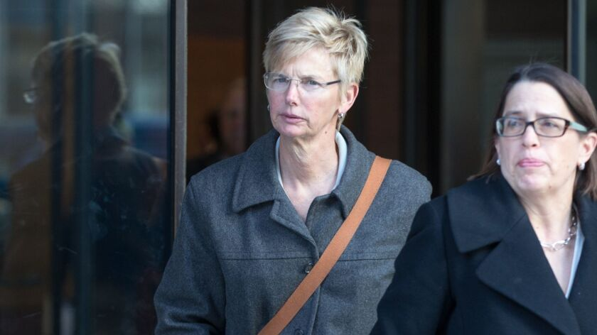 Donna Heinel, former USC senior associate athletic director, leaves federal court in Boston following her arraignment on March 25.