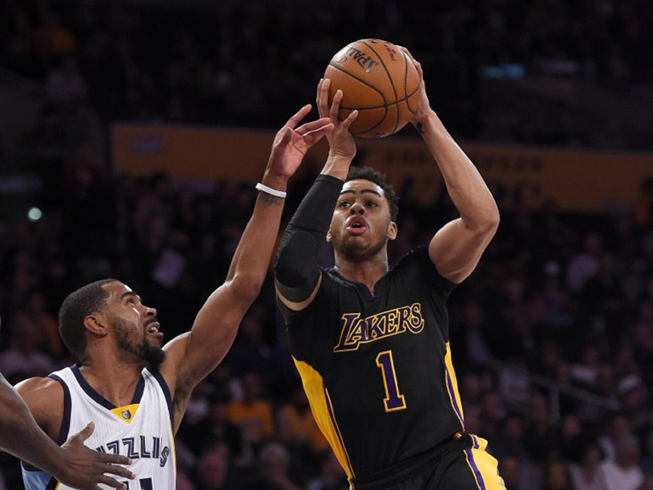 D'Angelo Russell drives to the basket against Memphis guard Mike Conley during the first half of the Lakers' 112-95 loss to the Grizzlies on Feb. 26 at Staples Center.