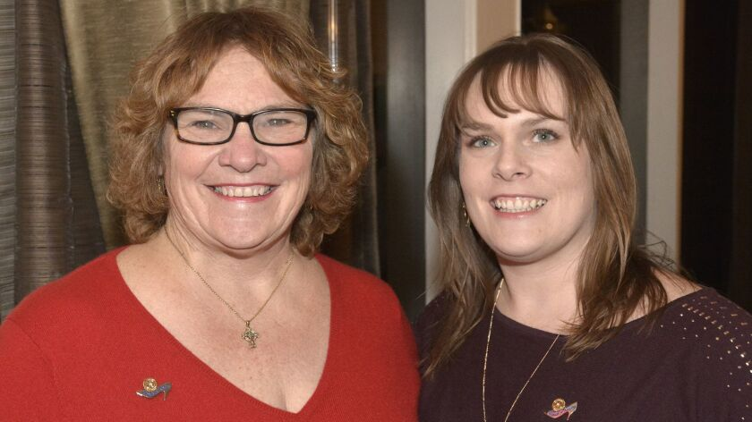 Former Burbank Police Captain Janice Lowers, left, who received the distinguished Women in Rotary Hi