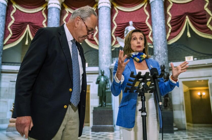 House Speaker Nancy Pelosi (D-San Francisco) and Senate Minority Leader Charles E. Schumer (D-N.Y.) speak to reporters.