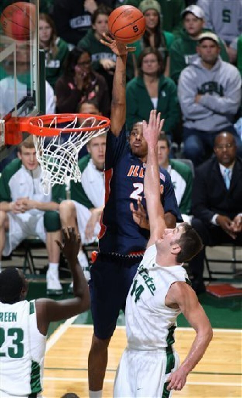 Illinois' Mike Davis, center, shoots over Michigan State's Goran Suton, right, and Draymond Green during the first half of an NCAA college basketball game Saturday, Jan. 17, 2009, in East Lansing, Mich. (AP Photo/Al Goldis)