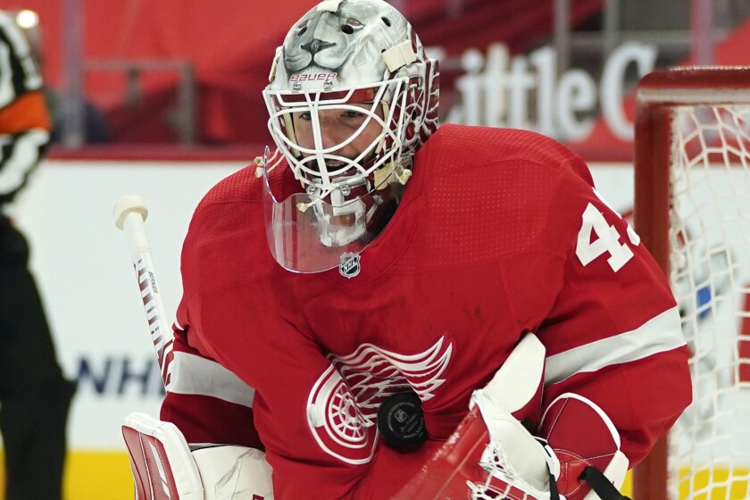 Detroit Red Wings goaltender Jonathan Bernier (45) stops a Tampa Bay Lightning shot in the third period of an NHL hockey game Thursday, March 11, 2021, in Detroit. (AP Photo/Paul Sancya)