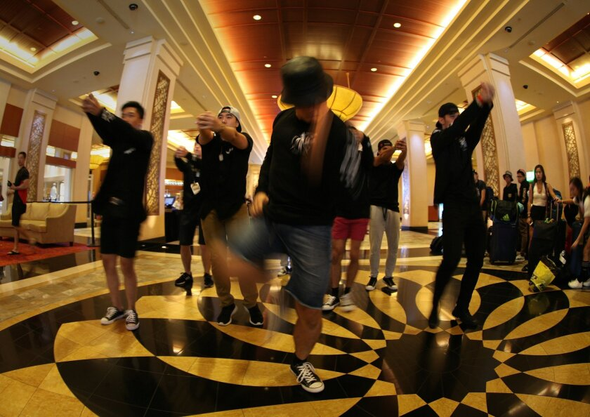 Members of the Romançon hip-hop crew from the Philippines show of their dance routine at the hotel lobby at the World Hip Hop Dance Championship at Harrah's Resort Southern California. They among the competitors to watch at Sunday's finals at Viejas Arena at SDSU.