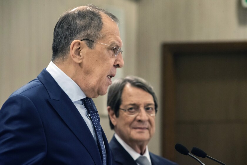 Russian Foreign Minister Sergey Lavrov, left, talks as the Cypriot President Nikos Anastasiades looks on prior to their meeting at the presidential palace in Nicosia, Cyprus, Tuesday, Sept. 8, 2020. Lavrov is paying an official visit to Cyprus amid heightened tensions over Turkey's search for energy resources in east Mediterranean waters where Greece and Cyprus claim as having exclusive economic rights. (Iakovos Hadjistavrou/Pool Photo via AP)