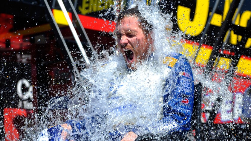 NASCAR Sprint Cup driver Brian Vickers participates in the ALS Ice Bucket Challenge following a practice session at Michigan International Speedway on Saturday.