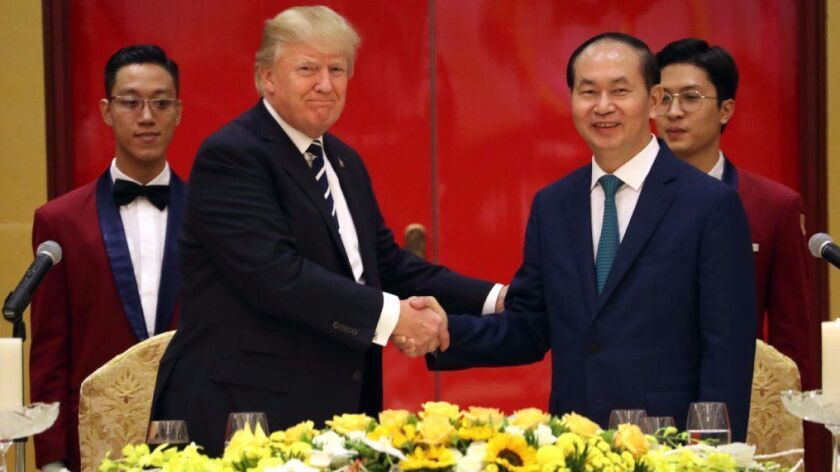 President Trump and Vietnamese President Tran Dai Quang attend a state dinner at the International Convention Center in Hanoi in November 2017.