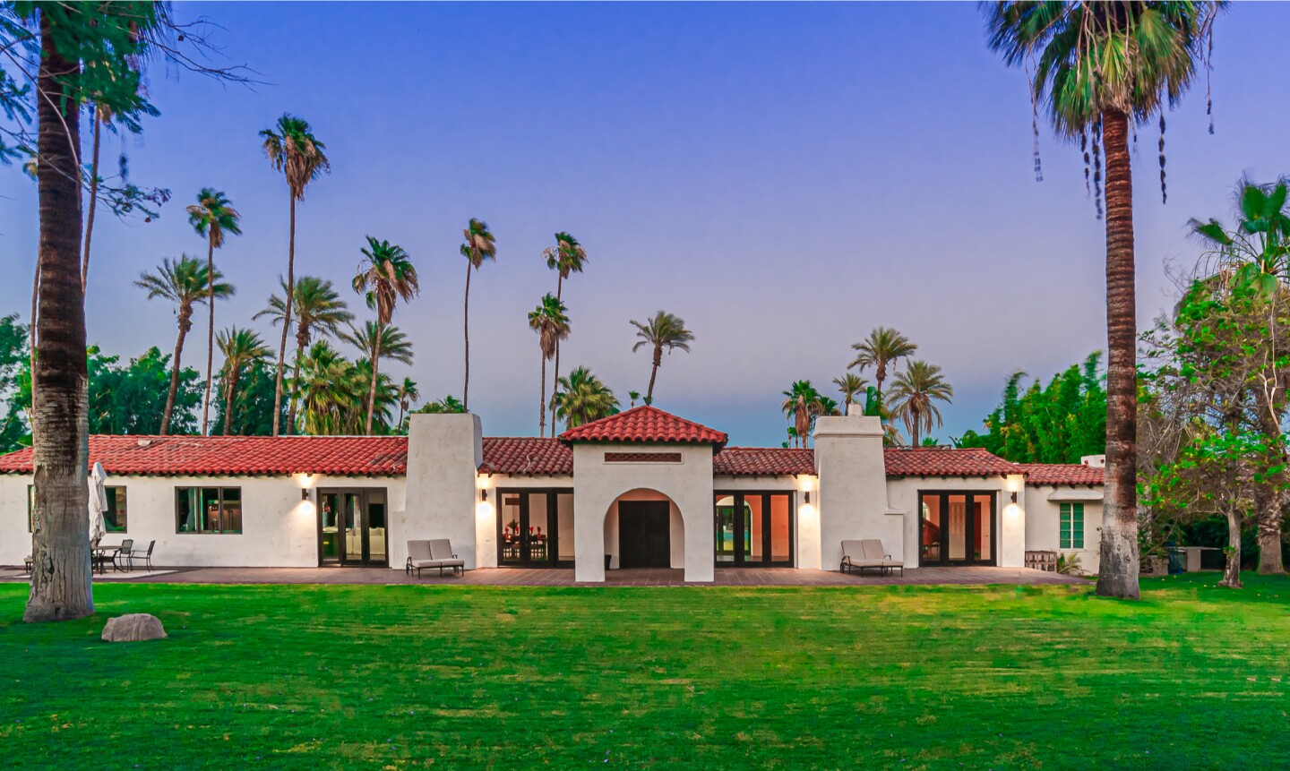The two-acre spread includes a Spanish Colonial-style home, guesthouse, swimming pool, sunken tennis court and cantina.