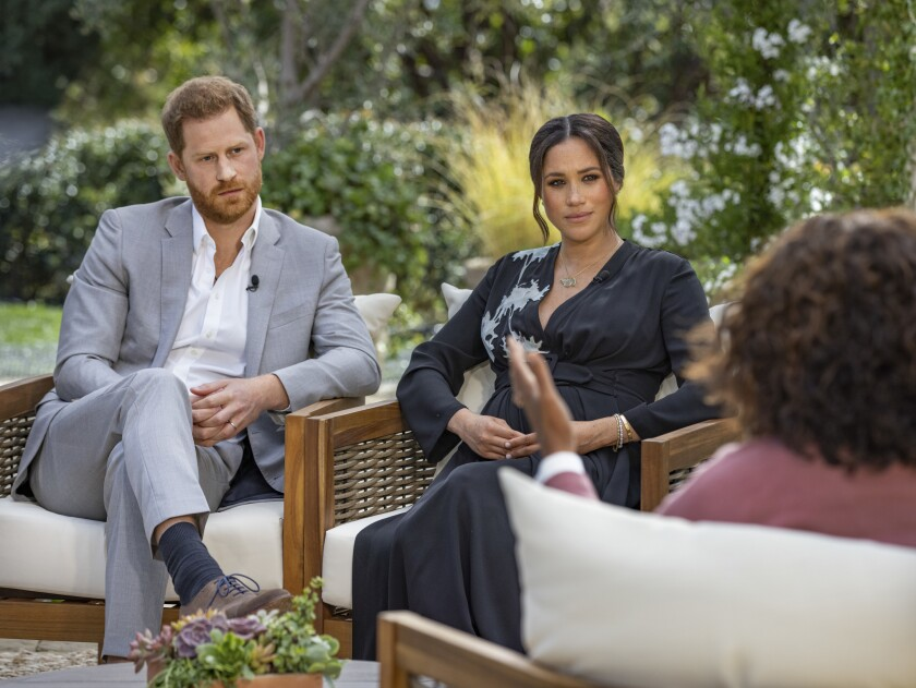 Meghan and Harry with Oprah on the patio of a home in Montecito.