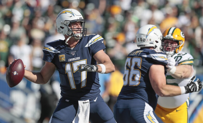Chargers quarterback Philip Rivers passes against the Packers.