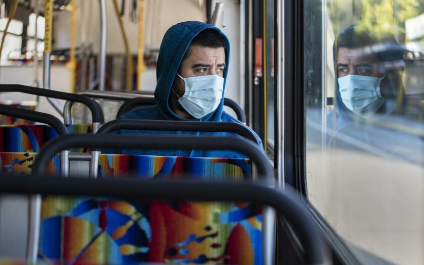 L.A. Metro passenger Danny Armada rides an Orange Line bus in Woodland Hills March 27.