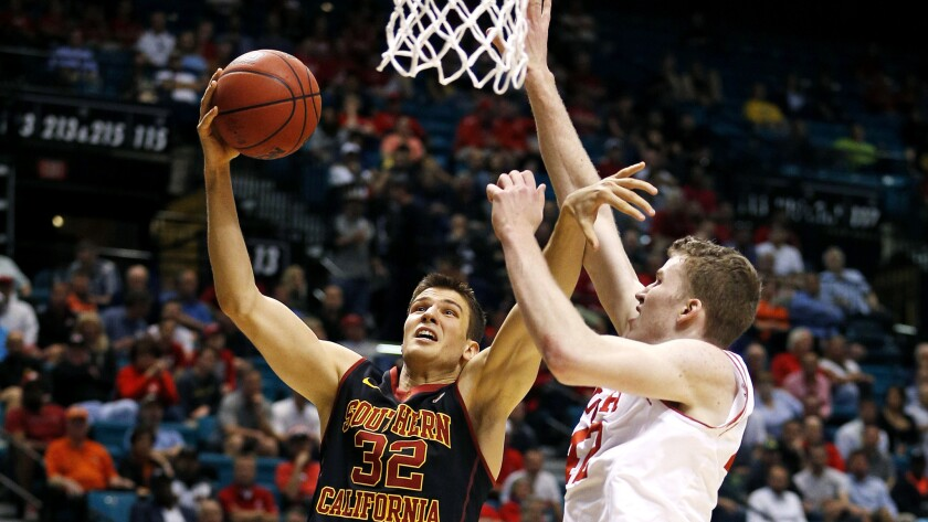 USCforward Nikola Jovanovic tries to score against Utah forward Jakob Poeltl during the first half of a game in March.