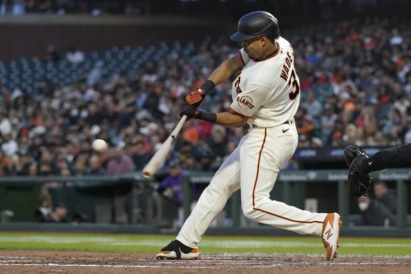 San Francisco Giants' LaMonte Wade Jr. hits a three-run home run against the Colorado Rockies during the fourth inning of a baseball game in San Francisco, Thursday, Aug. 12, 2021. (AP Photo/Jeff Chiu)