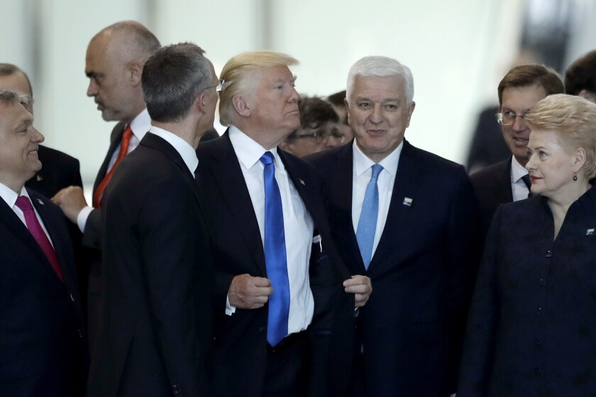 Montenegrin Prime Minister Dusko Markovic, center right, after apparently being pushed by President Trump during a NATO summit in Brussels.
