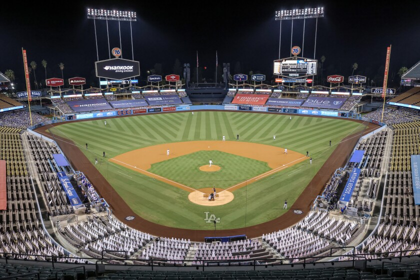 The Dodgers and the Brewers play in Game 2 of the MLB Wild Card playoffs at an empty Dodger Stadium.