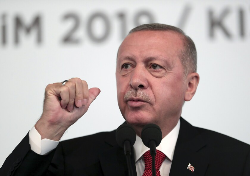 Turkey's President Recep Tayyip Erdogan, talks to to supporters during an event in Ankara, Turkey, Saturday, Oct. 5, 2019. Erdogan threatened Saturday to launch a solo military operation into northeastern Syria, where U.S. troops are deployed and have been trying to defuse tension between its NATO ally and Syrian Kurdish forces. (Presidential Press Service via AP, Pool)