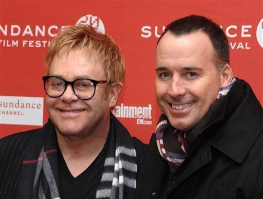 """FILE - In this Jan. 27, 2010 file photo, Elton John, left, and David Furnish attend the premiere of """"Nowhere Boy"""" during the 2010 Sundance Film Festival in Park City, Utah. (AP Photo/Peter Kramer, file)"""