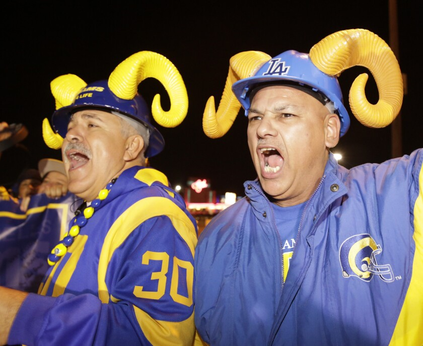"""Football fans cheer for the return of the Rams to Los Angeles on the site of the old Hollywood Park horse-racing track in Inglewood on Tuesday, Jan. 12, 2016. Should switching venues be an opportunity to switch up the uniforms? Some fans say: """"Don't mess with the horns."""""""