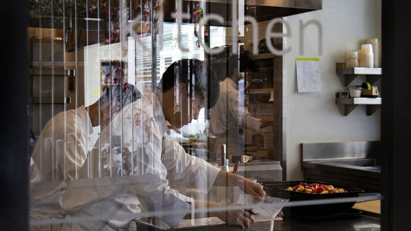 SAN FRANCISCO, CA - SEPTEMBER 12, 2018: Looking through the kitchen door, sioux chefs prep for dinne