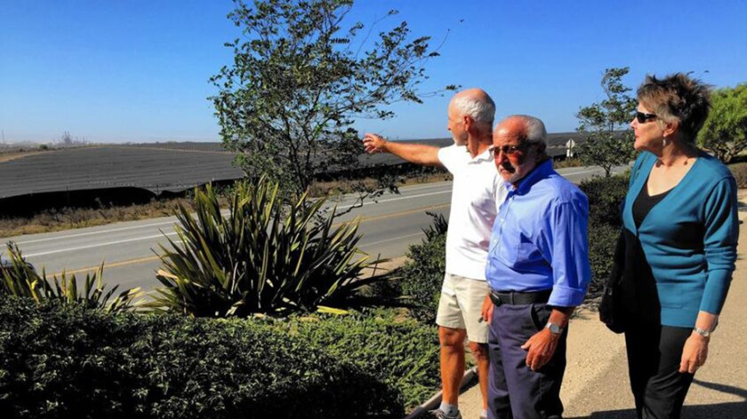 Nipomo residents Paul Stolpman, left, Laurance Shinderman and Linda Reynolds, photographed in 2015, gesture to the Phillips 66 oil refinery near their homes. (Robin Abcarian / Los Angeles Times)