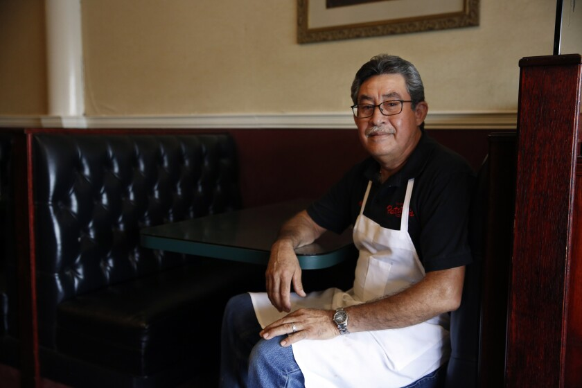 Manager Chuy Ortiz at Petrillo's pizza parlor on Valley Boulevard looks forward to welcoming back diners after a remodel.