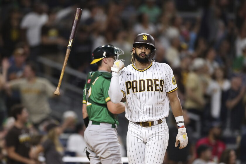 San Diego Padres' Fernando Tatis Jr. flips his bat after hitting a two-run home run against the Oakland Athletics during the third inning of a baseball game Tuesday, July 27, 2021, in San Diego. (AP Photo/Derrick Tuskan)