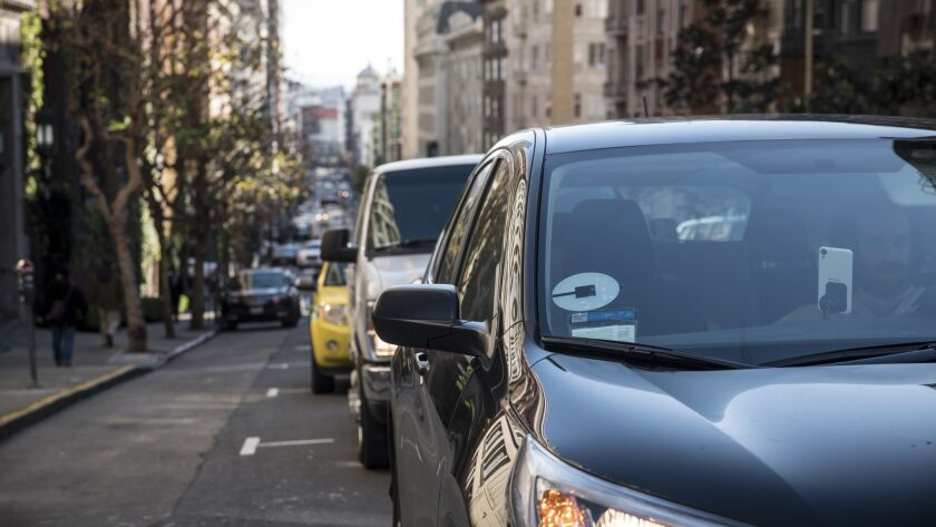 December 16, 2016 SAN FRANCISCO, CALIFORNIA Cars driven by people working as Uber drivers are seen
