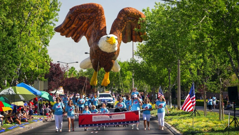 An oversized bald eagle soars along the parade route on a past Patriotic Parade in Summerlin, a suburban Las Vegas neighborhood.