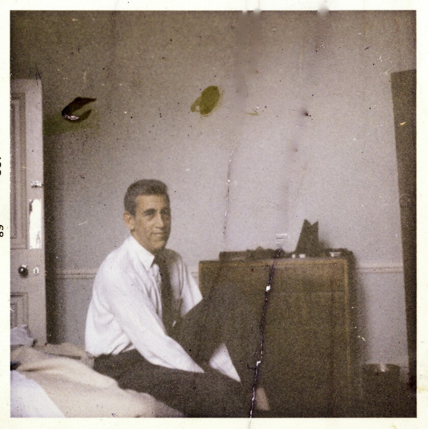 J.D. Salinger sitting on his bed at home in 1968.
