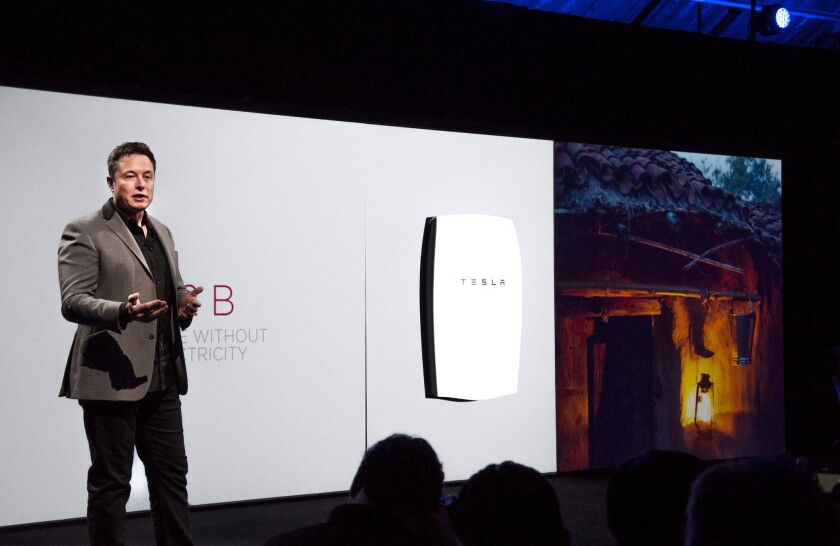 Tesla Motors CEO Elon Musk introduces the Powerwall residential battery at the automaker's design studio in Hawthorne on April 30, 2015.