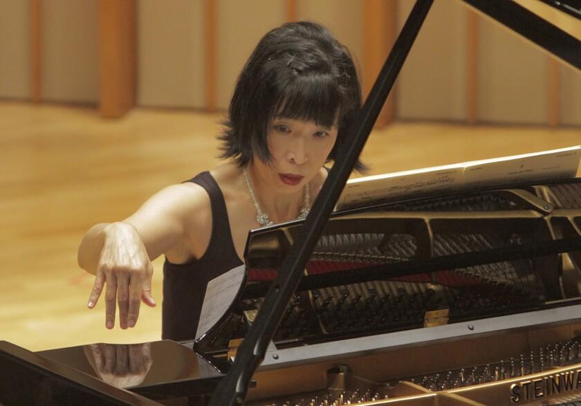 LOS ANGELES, CA NOV. 12, 2013. Pianist Gloria Cheng's recital of original piano works by 6 film com