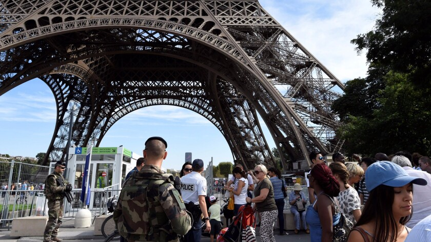 Police officers patrol around the Eiffel Tower in Paris on Sept. 10.