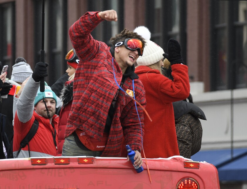 Kansas City Chiefs quarterback Patrick Mahomes cheers with the crowd during a parade through downtown Kansas City, Mo. Wednesday, Feb. 5, 2020 to celebrate the City Chiefs victory in the NFL's Super Bowl 54. (AP Photo/Reed Hoffmann)