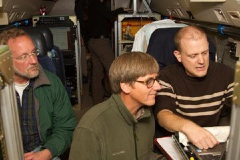 From left, Andy Watt of NCAR joins Ralph Keeling and Jonathan Bent of Scripps Institution of Oceanography, UCSD, on board the G-V. Photo: Carlye Calvin/UCAR