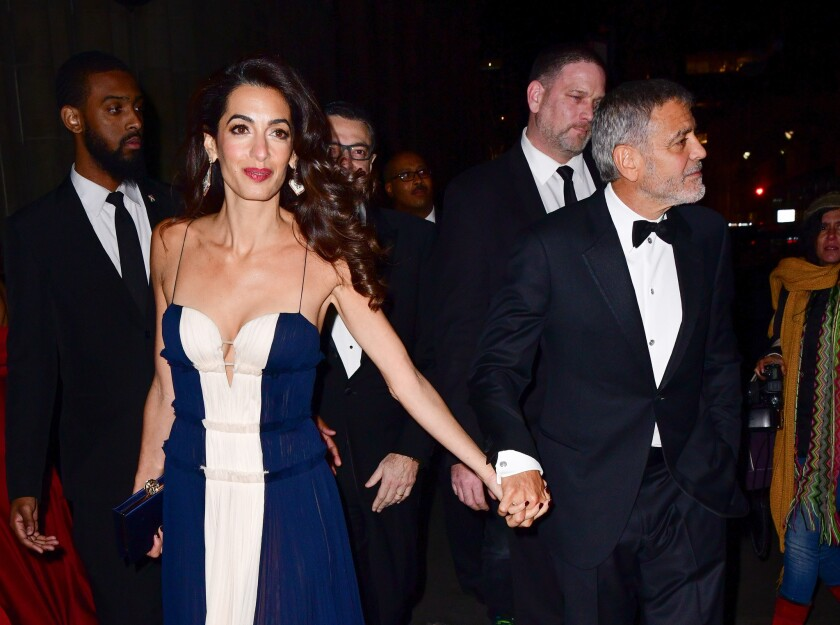 Amal Clooney and George Clooney leave United Nations Correspondents Association Awards at Cipriani 42nd Street Wednesday night.