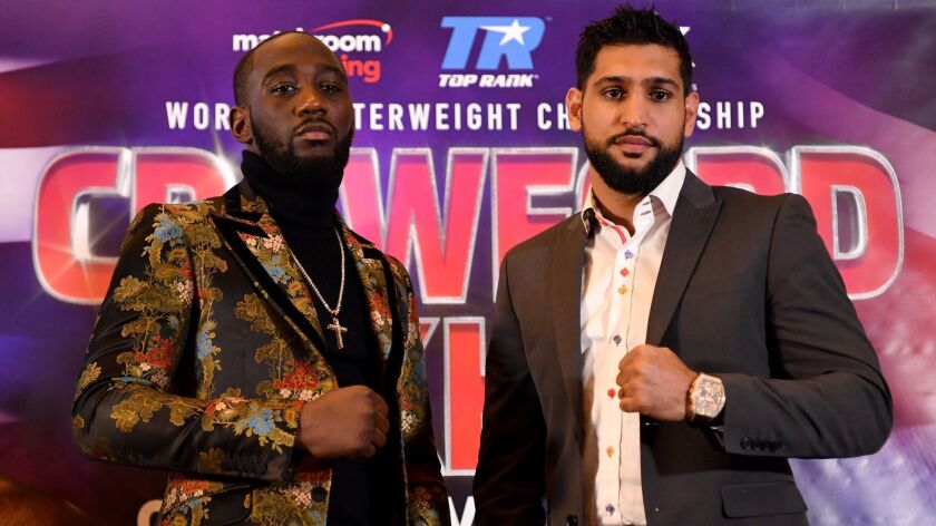 Terence Crawford, left, and Amir Khan pose during a news conference in London in January. The two boxers will meet in the ring Saturday in New York.