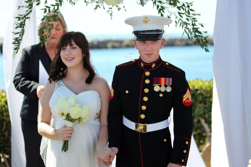 Cpl. Horak took his bride's hand and walked her from the ceremony.