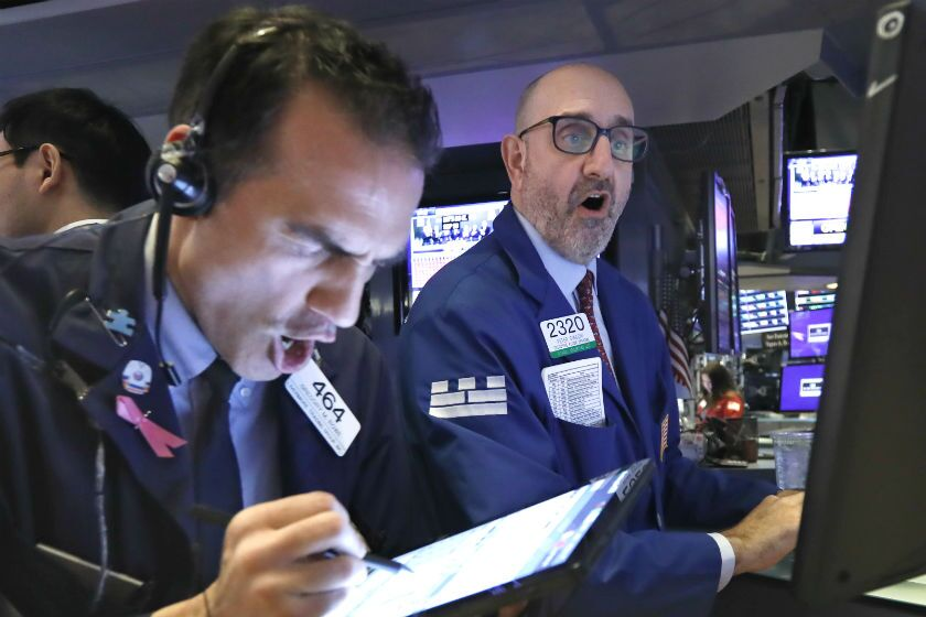 Trader Gregory Rowe, left, and specialist Peter Giacchi work on the floor of the New York Stock Exchange on Thursday.