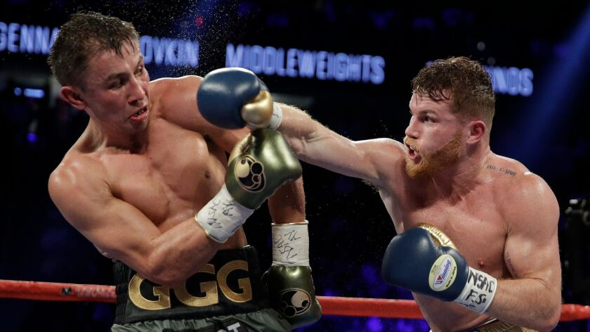 FILE - This Sept. 17, 2017 file photo shows Canelo Alvarez, right, fights Gennady Golovkin during a