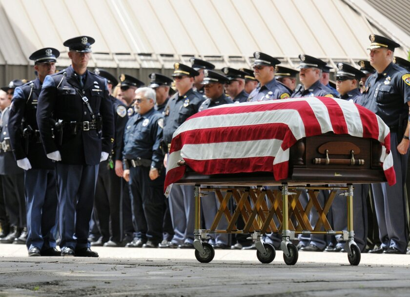Hundreds of law enforcement officers gather during the funeral of bailiff Joseph Zangaro, Friday, July 15, 2016, at Lake Michigan College's Mendel Center, in Benton Harbor, Mich. Zangaro was killed by a jail inmate during an escape attempt Monday, July 11, at the courthouse in St. Joseph, Mich. (Don Campbell/The Herald-Palladium via AP)